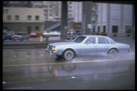 Car_in_rain_Seattle_1980s-591x394